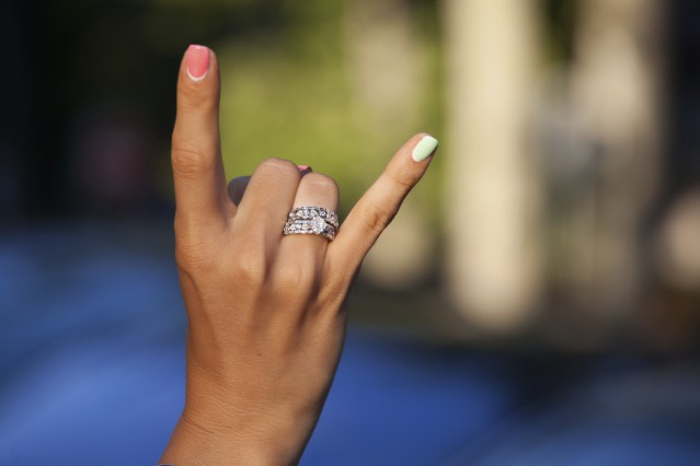 Woman hand with beautiful diamond rings. Beauty Fashion Glamorous. (soft focus)